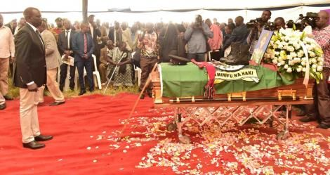 Deputy President William Ruto views Sergeant Kipyegon Kenei's Casket during his burial ceremony in Nakuru on Saturday, March 7, 2020.