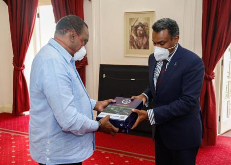 DPP Noordin Haji (right) presents the 2017/2018 and 2018/2019 Performance Report to President Uhuru Kenyatta at State House on Monday, November 9, 2020.