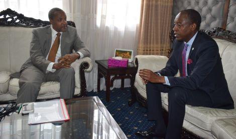 Foreign Affairs PS Macharia Kamau with Rwanda's High Commissioner to Kenya James Kimonyo in 2018
