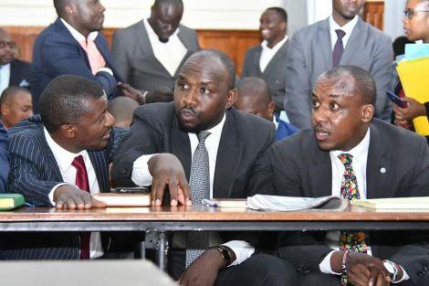 From left: Lawyer dan Maanzo, Kipchumba Murkomen, and Mutula Kilonzo Jr. deliberate during a court appearance.