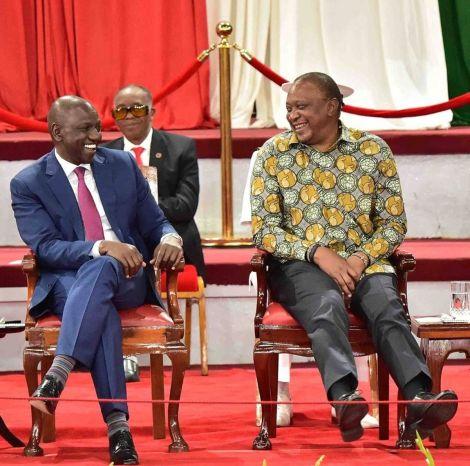 Deputy President William Ruto (left) and President Uhuru Kenyatta enjoy a hearty moment during the BBI launch at the Bomas of Kenya on November 27, 2019.