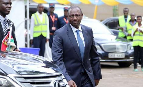 Deputy President William Ruto walking past his Lexus LX570.
