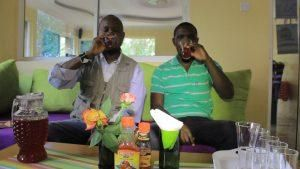 Director to Laikipia Permaculture Center (LPC) Joseph Lentunyoi (Left) and Advocacy officer at Participatory Ecological Land Use Management Association (PELUM) Benson Isoe drinking wine from Cactus.