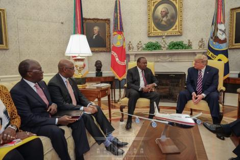 From left, Transport CS James Macharia, EAC CS Adan Mohamed, President Uhuru Kenyatta and US president Donald Trump during a meeting in the United States on February 6, 2020.