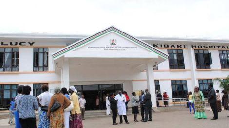 People stand outside the Mama Lucy Kibaki Hospital in Umoja II, Nairobi.