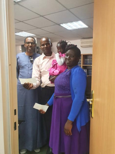 From Left: Constitutional lawyer Ahmednasir Abdullahi, a watchman Alfayo Omwenga, his wife and two children at the lawyer's office on Friday, February 21.