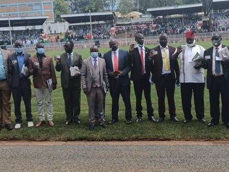 Some of the 10 recipients of Huduma Card displays them during Mashujaa Day Celebrations in Kisii on Tuesday, October 20, 2020.