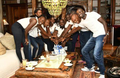 Elegeyo Marakwet Senator Kipchumba Murkomen (centre) cuts his birthday cake alongside family and friends on March 12, 2020.