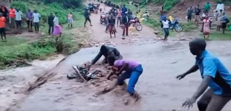 A boda boda rider and his colleague attempt to rescue a motorcycle on Saturday, April 18, 2020, in West Pokot.