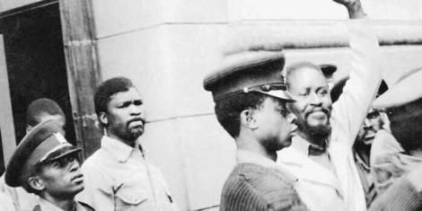 Former Prime Minister Raila Odinga (with his hand raised) and his former prison officer John Mwavuda in the 1980s