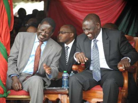 Former Prime Minister Raila Odinga and Deputy President William Ruto laughing at an event in October 2017.