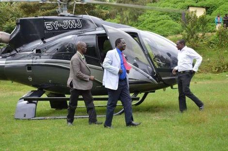 Former Prime Minister Raila Odinga stepping out of Jimmy Wanjigi's Eurocopter.