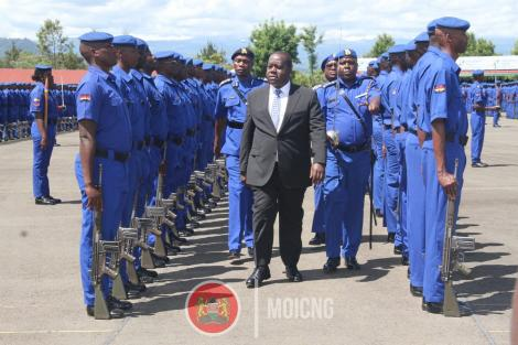 Interior Cabinet Secretary Fred Matiang'i inspects a guard of honour during a passing out parade for 1,224 officers in December 2019