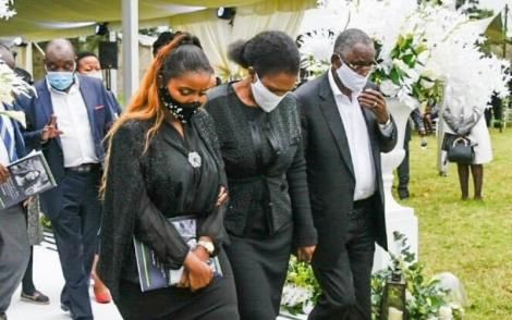 From left Anerlise, Tabitha and James Karanja pictured at the funeral of Tecra Karanja, May 16, 2020.