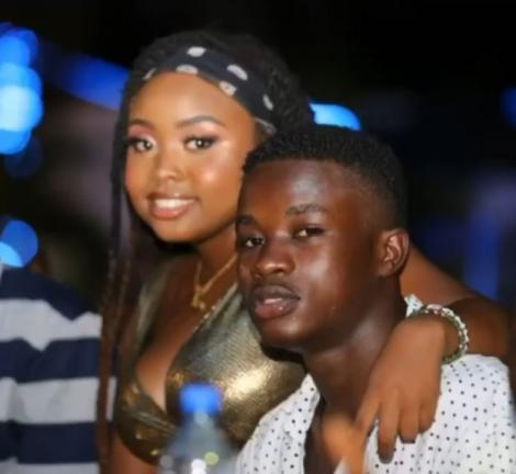 Gift Osinya (right) poses for a photo with a friend in 2019