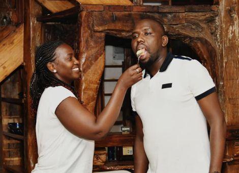 Gladys Wanjiru (left) and feeds her husband Elgeyo Marakwet Senator Kipchumba Murkomen with some cake during his birthday party on March 12, 2020.