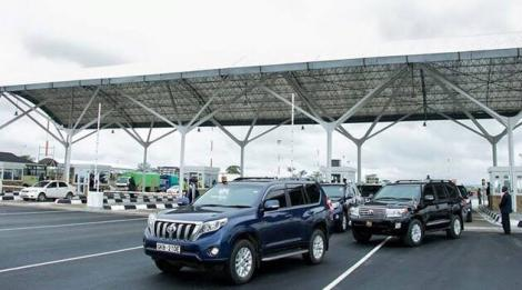 Government vehicles pictured at the JKIA exit area.