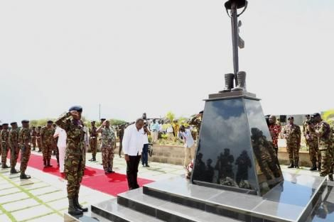 H. E. President Uhuru Kenyatta bows in respect after laying a wreath at Modika Barracks Heroes Monument during the barrack's inauguration ceremony on Friday 13 December 2019.