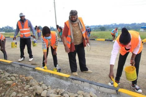Hannah Nyambura, second right, supervising a road project in Ol Kalou on July 25, 2020.