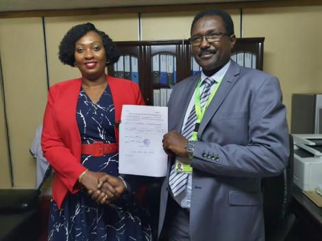 IEBC Nairobi County returning officer Joseph Eroo hands clearance certificate to Nairobi County Deputy Governor nominee Anne Kananu Mwenda for appointment.