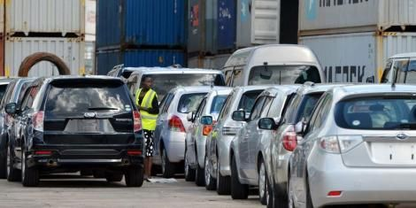 Imported cars at the port of Mombasa await clearance.