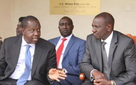 Interior Cabinet Secretary Dr Fred Mitiangi (left) speaks to Deputy William Ruto (right) at a past function.