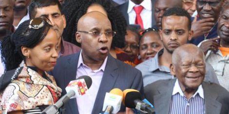 Jimmy Wanjigi (centre) addresses a press conference on October 18, 2017, as his fater Maina Wanjigi (right), and his wife Nsinza Wanjigi (left) look on.