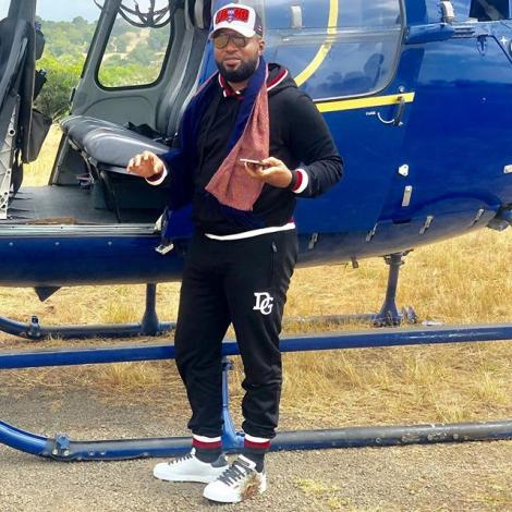 Mombasa Governor Ali Hassan Joho poses for a photo alongside a helicopter in 2019