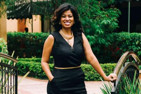 Media personality Julie Gichuru poses for a photo.