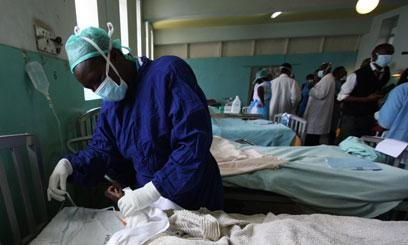 A doctor carrying out tests at the Kenyatta National Hospital.