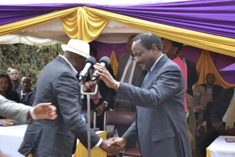 Kalonzo Musyoka interacts with Muthama Nduya at a past event