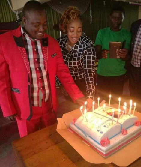 Pastor Victor Kanyari pictured cutting a cake during a ceremony at his church
