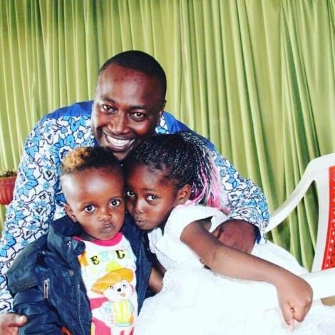A beaming Pastor Victor Kanyari poses with his children