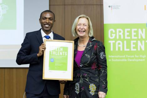 Kennedy Liti Mbeva receiving the Green Talents Fellowship Award, from the Federal Minister for Education and Research, in Berlin, Germany October 2014.