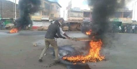 Kenyan residents fight fires started by rowdy youths on Sunday, October 4, 2020.