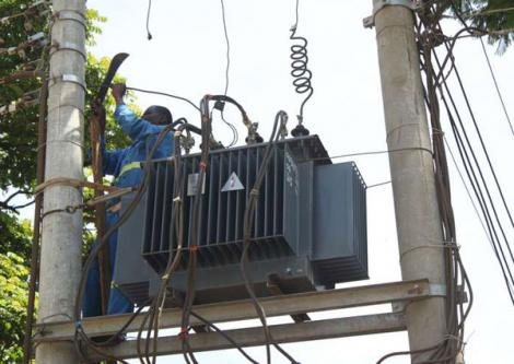 Kenya Power workers repair a transformer on the Meru-Makutano road on March 28, 2016.