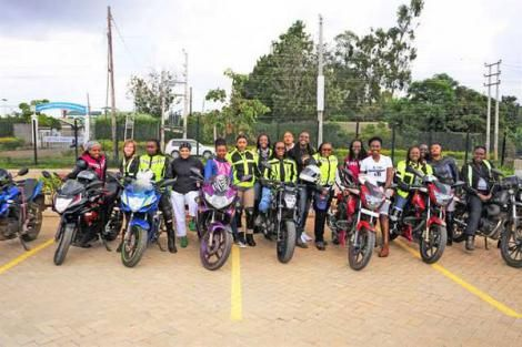 Kenyan ambassador for Women Riders World Relay, Ms Wamuyu Kariuki (centre), with other bikers and supporters at the Sax and Violins Lounge, the Waterfront, Karen, Nairobi on Sunday, January 12, 2020.