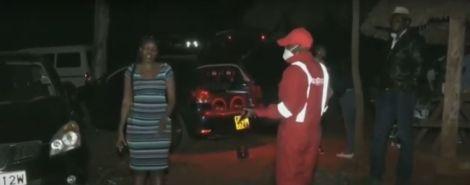Kiambu Police Commander Ali Hassan Nuno confronting a woman.