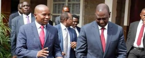 Tharaka Nithi Senator Kindiki Kithure (left) with Deputy President William Ruto (right) after attending a conference in 2019