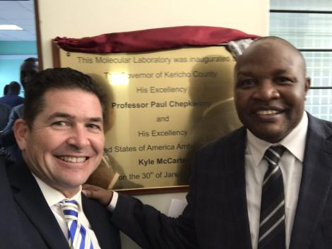 US Ambassador Kyle McCarter poses with Kericho Governor Paul Chepkwony after unveiling medical equipment in Kericho on January 30, 2020