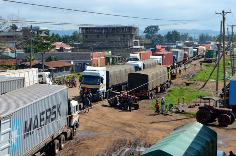 Long distance truck drivers line up before crossing into Uganda.