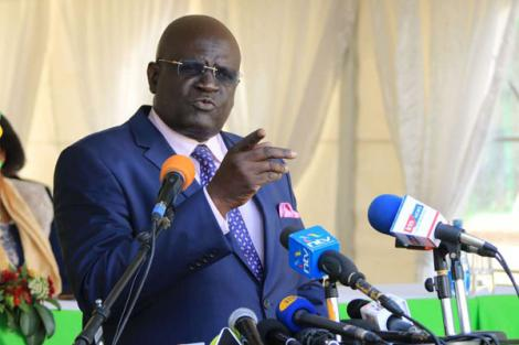 Education CS George Magoha addresses the media outside KNEC headquarters, Nairobi in November 2019