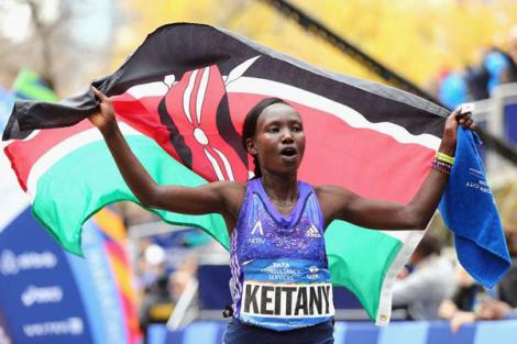 Mary Keitany celebrates after winning the Pro Women's division during the 2015 TCS New York City Marathon in Central Park on November 1, 2015