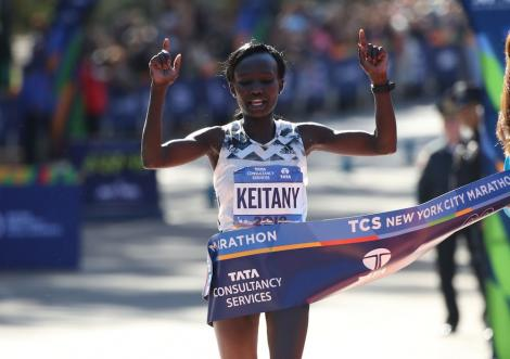 Mary Keitany crosses the finish line in Central Park to win the women's division of the 2018 New York City Marathon on Nov. 4 in Central Park.