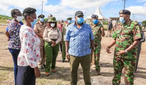 Interior CS Fred Matiang'i (centre) flanked by IG Hillary Mutyambai (right) and other security officials in Kangundo on May 1, 2020.