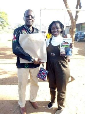 Activist Juliet Wanjira (Right) pitured receiving a donation of books from former Chief Justice Willy Mutunga