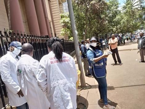 Medics conducting random screening for Covid-19 symptoms at National Archives, Nairobi on Saturday, March 21, 2020