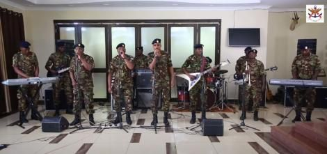 Members of the Maroon Commandos performing their latest song titled Corona.