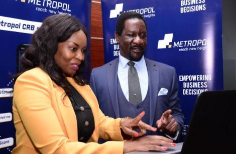 Group Managing Director & CEO Sam Omukoko and the Esther Marugah,General Manager Metropol CRB LTD during the launch on June 19, 2020.