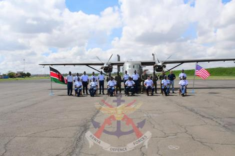 Military officials pose for a photo after the commission of the C-145 Skytruck aircraft by KDF on Tuesday, April 21, 2021